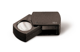 Folding magnifier with PXM<sup>&reg;</sup> lens